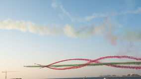 Aerobatic team performs flight at air show. Stock Photo