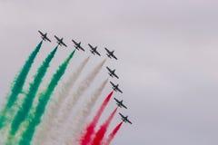 Aerobatic team performs flight,, Air show. Aerobatic team performs flight, Planes flying in formation, Air show royalty free stock photo