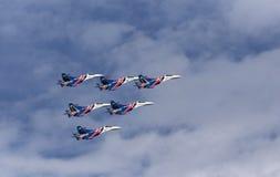 Aerobatic team performs flight at air show Stock Images