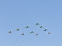 Aerobatics aircraft of the Victory Parade. Moscow - May 7th, 2015: Military aircraft painted in the blue sky aerobatics in honor of the seventieth birthday of Royalty Free Stock Photos