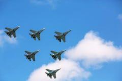 Aerobatics. A group of Russian Su-27 performing group aerobatics at an airshow Royalty Free Stock Photography