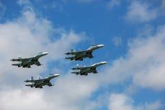 Aerobatics. A group of Russian Su-27 performing group aerobatics at an airshow Royalty Free Stock Photos