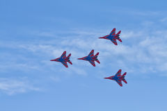 Aerobatics performed by aviation group of aerobatics Military-ai Royalty Free Stock Image