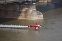 Aerobatics Show. BUDAPEST, HUNGARY - MAY 1: Zoltan Veres fly under the Chainbridge as part of the May 1 celebration of 2014. Zoltan Veres is an European champion Stock Images