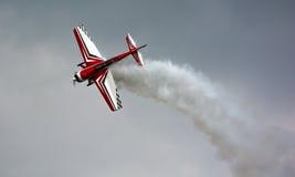 Aerobatics With Smoke. Aerobatics Airplane Flying Figure With Smoke Royalty Free Stock Photo