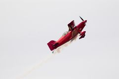 Aerobatics Trick. A specially made stunt plane performs for the crowd at an air show Royalty Free Stock Photography