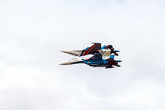 Aerobatics. Two fighters. Mirror Royalty Free Stock Images