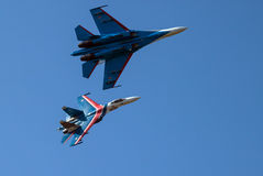 Aerobatics. Two heavy fighters. Royalty Free Stock Image