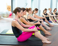Aerobic Pilates personal trainer group class. Aerobic Pilates personal trainer women at gym group class in a row Stock Photography
