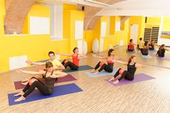 Aerobic Pilates. Personal trainer instructor in gym fitness class Stock Image
