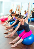 Aerobic Pilates women group with stability ball. In a row on mirror gym Royalty Free Stock Images