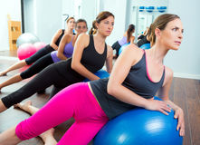 Aerobic Pilates women group with stability ball. In a row on mirror gym Stock Photography