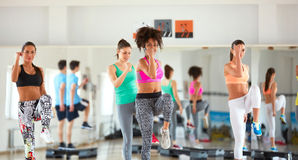 Aerobic training with female instructor Stock Image