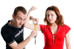 Aerobics. Instructor helps young lady to build some muscules stock image