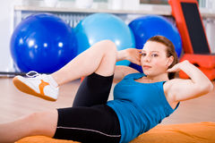 Aerobics 14. Young woman exercising in a step aerobics class royalty free stock photography