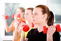 Aerobics 15. Young woman exercising in a step aerobics class stock photo