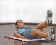 Aerobics 2. Image of a young woman doing a floor aerobic exercise in a gym.Shot with Canon 70-200mm f/2.8L IS USM Royalty Free Stock Photography