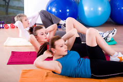Aerobics. Young women exercising in a step aerobics class royalty free stock images