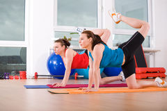 Aerobics 6. Young women exercising in a step aerobics class stock images