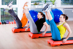Aerobics. Young women exercising in a step aerobics class stock images