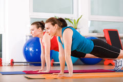 Aerobics 9. Young women exercising in a step aerobics class royalty free stock photo