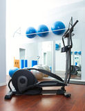 Aerobics cardio training elliptic crosstrainer. Bicycle device at gym Stock Photos
