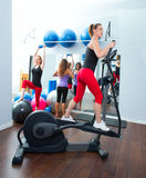 Aerobics cardio training woman on elliptic. Aerobics cardio training women on elliptic crosstrainer bicycle at gym Royalty Free Stock Photos