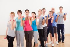 Aerobics class working out with dumbbells Royalty Free Stock Photo
