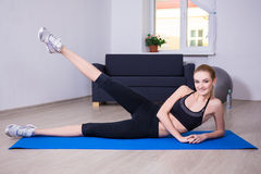 Aerobics concept - slim flexible woman doing stretching exercise Royalty Free Stock Images
