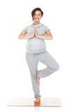 Aerobics di pratica della donna incinta Fotografie Stock