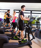 Aerobics elliptical walker trainer group at gym Royalty Free Stock Photo