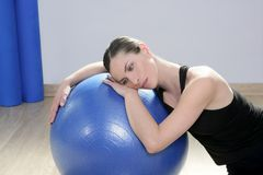 Aerobics fitness woman pilates stability blue bal. Aerobics fitness woman relax pilates stability blue ball in sport gym Stock Image