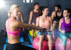 Aerobics with flare against a gym room background Royalty Free Stock Photography