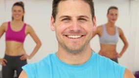 Aerobics instructor smiling at camera stock footage