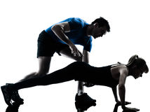 Aerobics intstructor  with mature woman exercising Stock Images