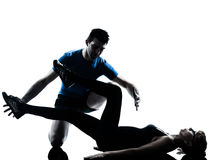 Aerobics intstructor  with mature woman exercising silhouette Stock Image