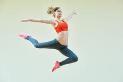Aerobics jumping fitness exercises Royalty Free Stock Photos