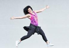 Aerobics jumping fitness exercises Stock Image