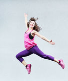 Aerobics jumping fitness exercises Stock Images