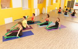 Aerobics pilates group with rubber bands. In a row at fitness gym Royalty Free Stock Image