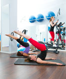 Aerobics pilates gym women group and crosstrainer. Aerobics pilates women with magic ring and crosstrainer Royalty Free Stock Image
