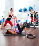 Aerobics pilates gym women group and crosstrainer. Aerobics pilates gym women personal trainer with ribber band Stock Photos