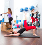 Aerobics pilates gym women group and crosstrainer. Aerobics pilates gym women group with crosstrainer Stock Photo