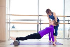 Aerobics Pilates personal trainer helping women Stock Photos