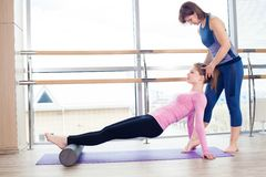 Aerobics Pilates personal trainer helping women Royalty Free Stock Image