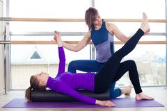 Aerobics Pilates personal trainer helping women. Group in a gym class royalty free stock photos