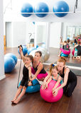 Aerobics pilates women kid girls personal trainer Stock Photos