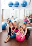 Aerobics pilates women kid girls personal trainer. Instructors at gym stock photos
