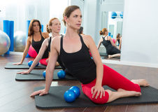 Aerobics pilates women with toning balls in a row Stock Photos