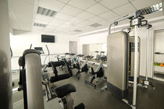 Aerobics spinning exercise bikes gym room Stock Photo